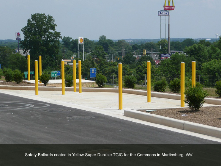 Tall yellow bollards with TGIC coating.