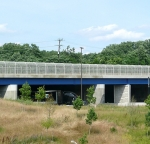 Beige TGIC polyester covered bridge in MD.