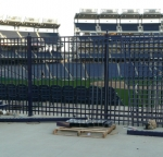 TGIC coated blue fence at ballpark.