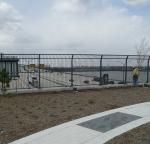Anti-climb fence with gray durable TGIC coating.