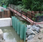 Z piling under bridge with bonded epoxy coating.