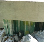 Green piling with an epoxy safety powder finish.
