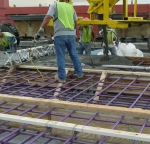 Pre-fabricated bars coated in purple fusion bonded epoxy.