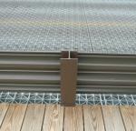 Bridge guard rail covered in TGIC polyester powder.