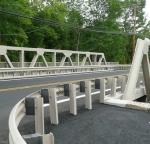 Bridge rail with white TGIC polyester coating.