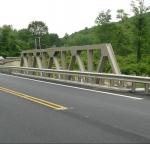 Bridge with beige TGIC polyester powder coating.