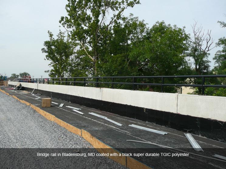 Bridge rail with black safety powder coating.