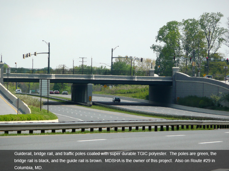 Bridge rail and traffic poles with polyester coating.