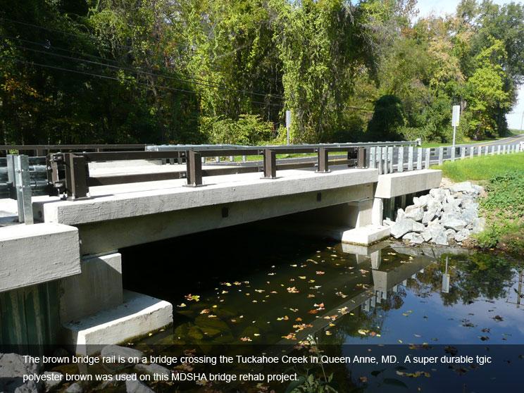 Brown bridge rail with durable TGIC polyester powder coat.