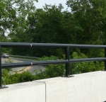 Rail covered in TGIC polyester coating.