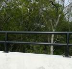 Bridge guard rail with safety coating.