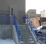 Stair rails with blue TGIC polyester powder.