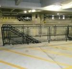Garage railing with black polyester powder.