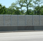 Highway sound walls coated in durable polyester.