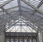Beams coated in TGIC polyester powder.